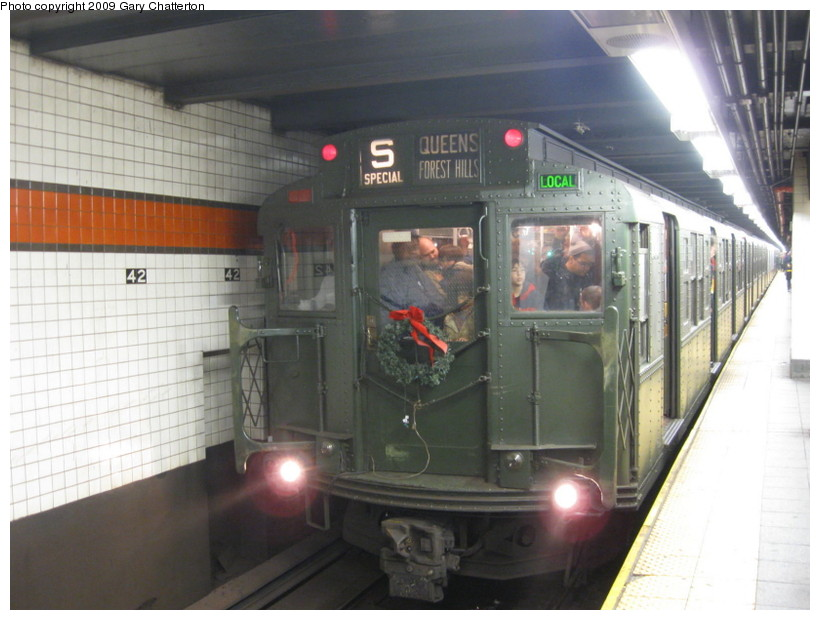 (121k, 820x620)<br><b>Country:</b> United States<br><b>City:</b> New York<br><b>System:</b> New York City Transit<br><b>Line:</b> IND 6th Avenue Line<br><b>Location:</b> 42nd Street/Bryant Park <br><b>Route:</b> Museum Train Service (V)<br><b>Car:</b> R-1 (American Car & Foundry, 1930-1931) 100 <br><b>Photo by:</b> Gary Chatterton<br><b>Date:</b> 12/14/2008<br><b>Viewed (this week/total):</b> 4 / 909