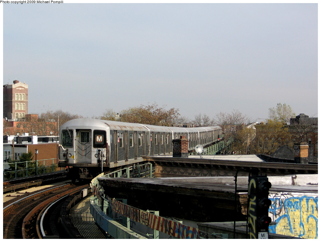 (253k, 1044x788)<br><b>Country:</b> United States<br><b>City:</b> New York<br><b>System:</b> New York City Transit<br><b>Line:</b> BMT Myrtle Avenue Line<br><b>Location:</b> Fresh Pond Road <br><b>Route:</b> M<br><b>Car:</b> R-42 (St. Louis, 1969-1970)  4750 <br><b>Photo by:</b> Michael Pompili<br><b>Date:</b> 12/2/2004<br><b>Viewed (this week/total):</b> 1 / 624