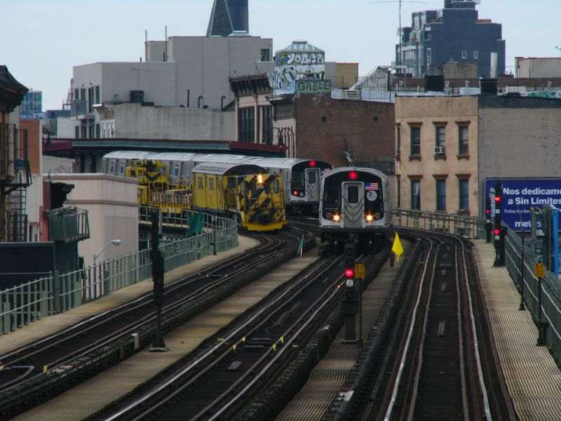 (101k, 800x600)<br><b>Country:</b> United States<br><b>City:</b> New York<br><b>System:</b> New York City Transit<br><b>Line:</b> BMT Nassau Street/Jamaica Line<br><b>Location:</b> Lorimer Street <br><b>Route:</b> M<br><b>Car:</b> R-160A-1 (Alstom, 2005-2008, 4 car sets)   <br><b>Photo by:</b> Bill E.<br><b>Date:</b> 2/28/2009<br><b>Notes:</b> Two R160 M trains and locomovtive #884.<br><b>Viewed (this week/total):</b> 4 / 1853