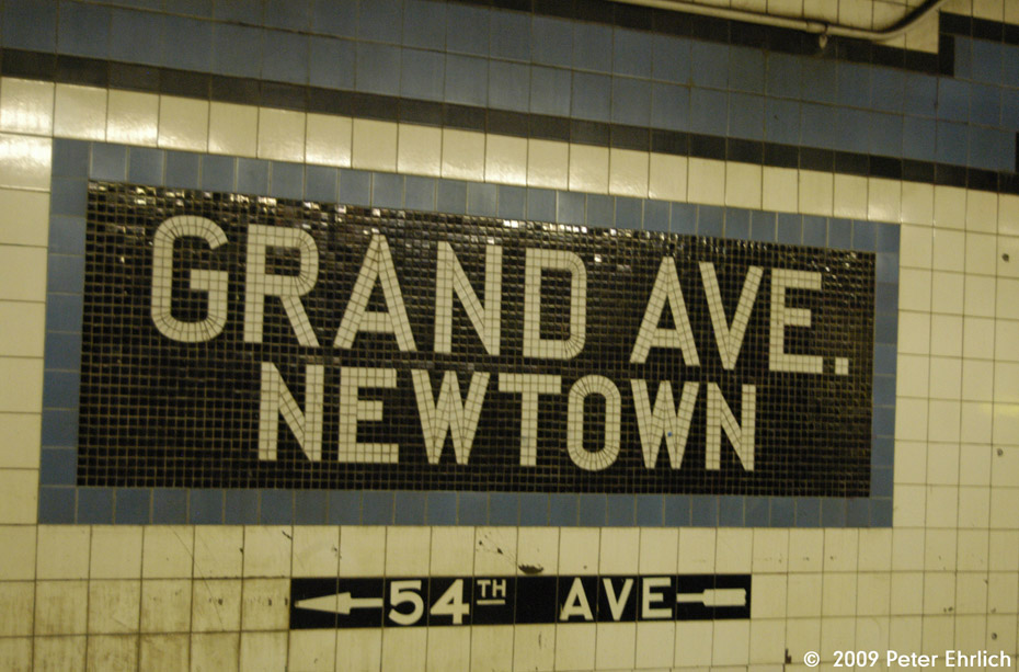(197k, 930x613)<br><b>Country:</b> United States<br><b>City:</b> New York<br><b>System:</b> New York City Transit<br><b>Line:</b> IND Queens Boulevard Line<br><b>Location:</b> Grand Avenue/Newtown <br><b>Photo by:</b> Peter Ehrlich<br><b>Date:</b> 2/24/2009<br><b>Notes:</b> Station tilework.<br><b>Viewed (this week/total):</b> 0 / 599