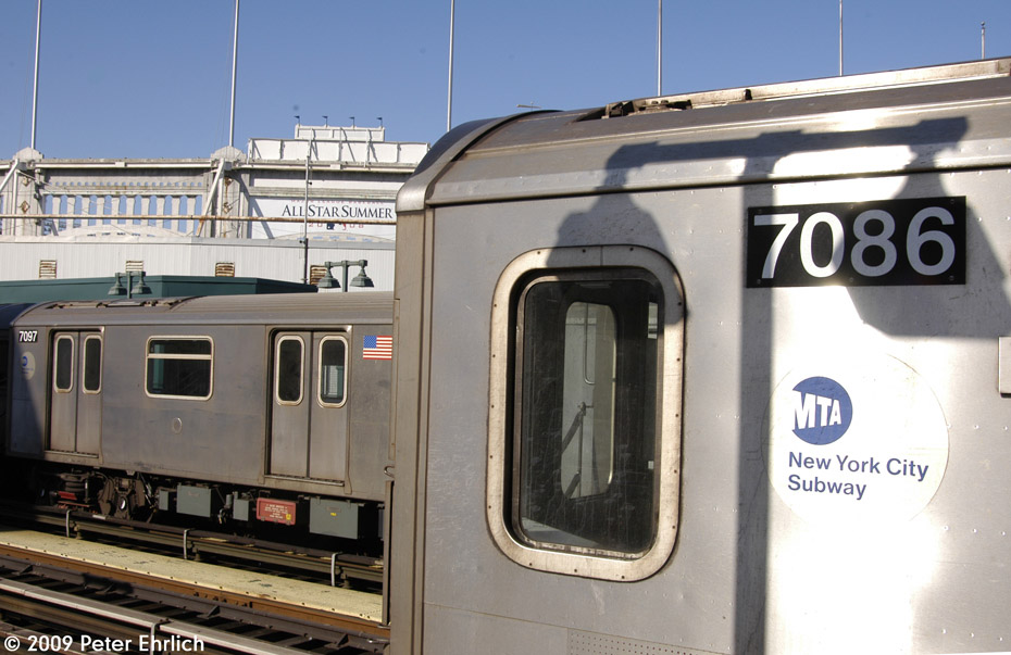 (182k, 930x603)<br><b>Country:</b> United States<br><b>City:</b> New York<br><b>System:</b> New York City Transit<br><b>Line:</b> IRT Woodlawn Line<br><b>Location:</b> 161st Street/River Avenue (Yankee Stadium) <br><b>Route:</b> 4<br><b>Car:</b> R-142 (Option Order, Bombardier, 2002-2003)  7086 <br><b>Photo by:</b> Peter Ehrlich<br><b>Date:</b> 3/4/2009<br><b>Notes:</b> Outbound. With 7097 inbound.<br><b>Viewed (this week/total):</b> 0 / 900