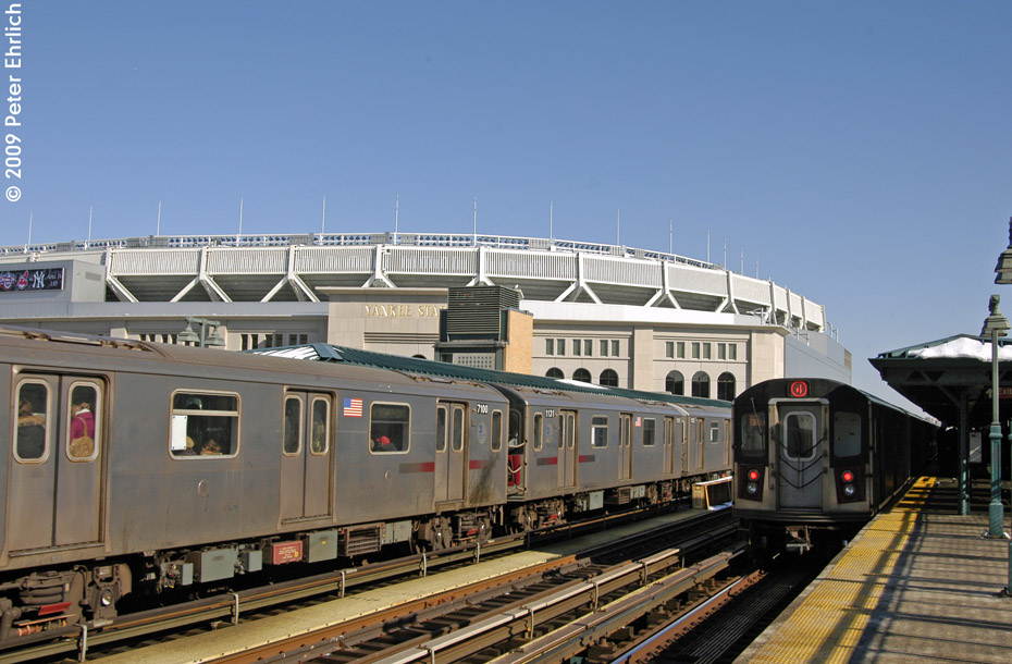 (197k, 930x610)<br><b>Country:</b> United States<br><b>City:</b> New York<br><b>System:</b> New York City Transit<br><b>Line:</b> IRT Woodlawn Line<br><b>Location:</b> 161st Street/River Avenue (Yankee Stadium) <br><b>Route:</b> 4<br><b>Car:</b> R-142 (Option Order, Bombardier, 2002-2003)  7100 <br><b>Photo by:</b> Peter Ehrlich<br><b>Date:</b> 3/4/2009<br><b>Notes:</b> Inbound. Coupled to 1121.<br><b>Viewed (this week/total):</b> 2 / 994