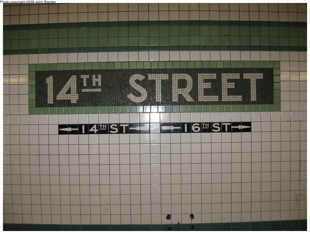 (212k, 1044x788)<br><b>Country:</b> United States<br><b>City:</b> New York<br><b>System:</b> New York City Transit<br><b>Line:</b> IND 6th Avenue Line<br><b>Location:</b> 14th Street <br><b>Photo by:</b> John Barnes<br><b>Date:</b> 3/15/2009<br><b>Notes:</b> Mosaic name tablet.<br><b>Viewed (this week/total):</b> 0 / 468