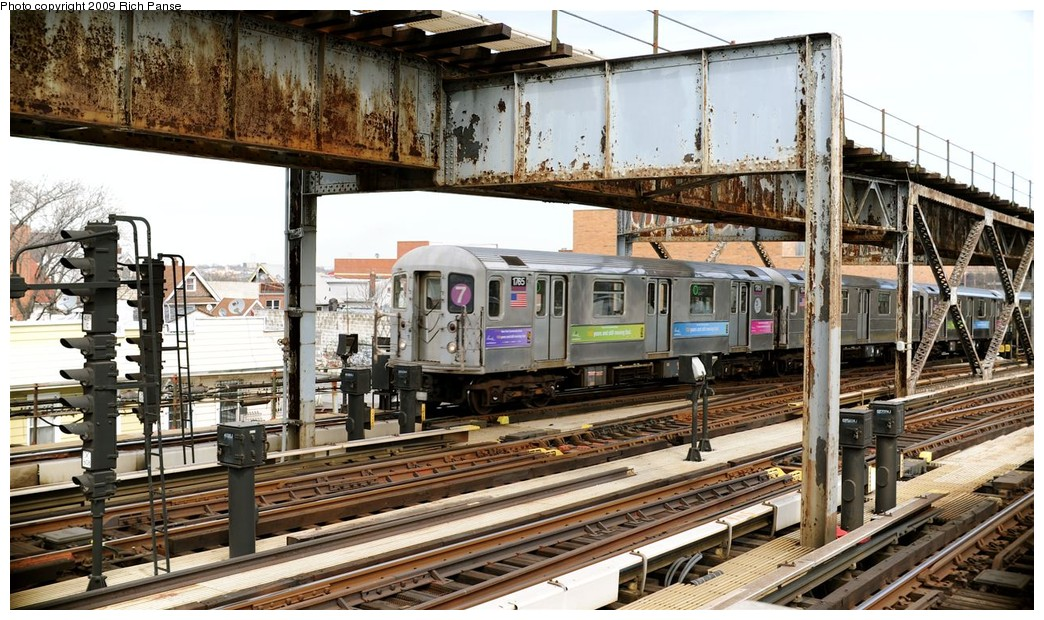 (240k, 1044x620)<br><b>Country:</b> United States<br><b>City:</b> New York<br><b>System:</b> New York City Transit<br><b>Line:</b> IRT Flushing Line<br><b>Location:</b> 111th Street <br><b>Route:</b> 7<br><b>Car:</b> R-62A (Bombardier, 1984-1987)  1765 <br><b>Photo by:</b> Richard Panse<br><b>Date:</b> 3/25/2009<br><b>Viewed (this week/total):</b> 3 / 1326