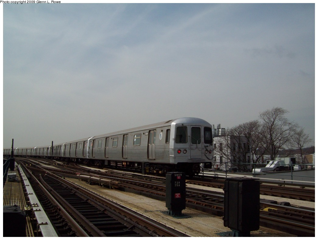 (167k, 1044x788)<br><b>Country:</b> United States<br><b>City:</b> New York<br><b>System:</b> New York City Transit<br><b>Line:</b> IND Fulton Street Line<br><b>Location:</b> Lefferts Boulevard <br><b>Route:</b> A<br><b>Car:</b> R-46 (Pullman-Standard, 1974-75) 6154 <br><b>Photo by:</b> Glenn L. Rowe<br><b>Date:</b> 3/27/2009<br><b>Viewed (this week/total):</b> 2 / 720