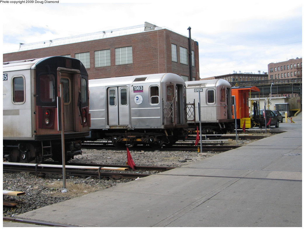 (228k, 1044x788)<br><b>Country:</b> United States<br><b>City:</b> New York<br><b>System:</b> New York City Transit<br><b>Location:</b> 207th Street Yard<br><b>Photo by:</b> Doug Diamond<br><b>Date:</b> 4/7/2009<br><b>Notes:</b> R142, R62 1983, R134 EP014, and LIRR Caboose 60<br><b>Viewed (this week/total):</b> 1 / 414